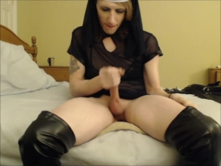 Slutty tranny nun with thigh high boots sits on a buttplug and jerks off