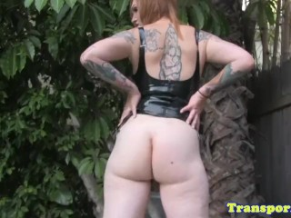 Tattooed latex tgirl pulling hard cock solo
