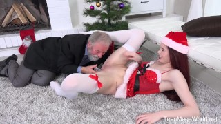 Old n Young.com Lovenia Lux Ginger elf finds a dildo under Christmas tree