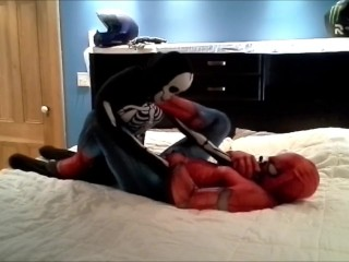 spiderman having fun with his toy skeleton