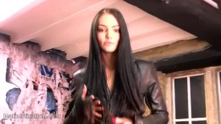 Preview 1 of Brunette strips off leather catsuit spreads pussy and masturbates gold toy