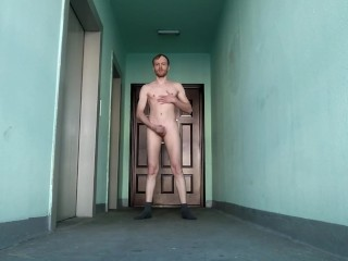 Wanking naked in the stairwell