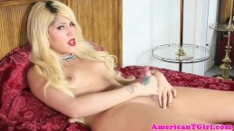 Busty blonde tgirl spreads legs to wank cock