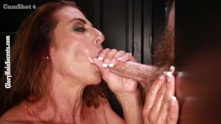 Female bodybuilder swallowing cum in a gloryhole