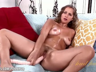 Miss Melrose oils up and fucks herself with toy
