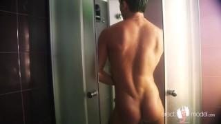 Wet smooth guy showering in jockstrap, masterbating and cumming in dance