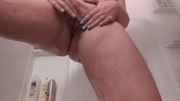 Girl masturbates in shower.