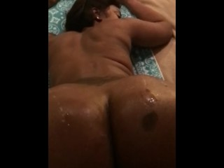 Pouring oil on her phat ass while I fuck her