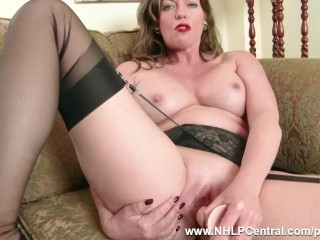 The Adult Video Experience Presents Redhead Milf masturbates in vintage lingerie nylons in kinky dildo session