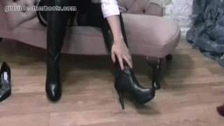 Sexy secretary babe slowly pulls on her leather thigh boots over her nylons