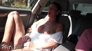 Real amateur girl masturbates in the car on the city streets