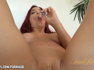 Redhead with perfect tits uses her glass dildo.