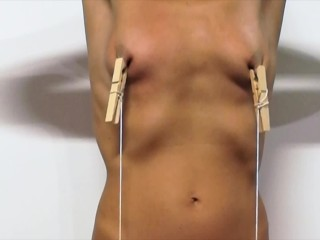 Nipples exercise. Two apples tied to the nipples.