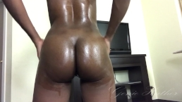 Naked ebony oiled up and shaking ass