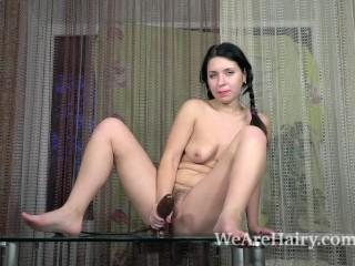 Tanita gets nude and masturbates on her table