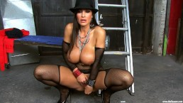 Stunning MILF Lisa Ann shows off huge boobs and masturbates in a garage