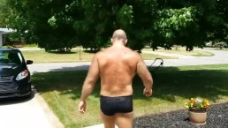 Mowing the lawn in short shorts