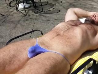 Sunning in a purple thong bikini where my neighbors can see
