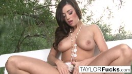 Taylor plays with her favorite toy outdoors