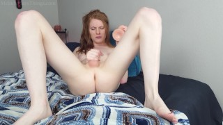 Skinny redhead fucks a giant dildo and plays with girl cock until she cums