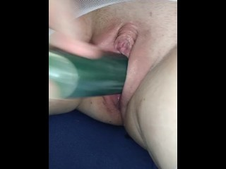 Naughty Nicole fucks her wet pussy with a cucumber