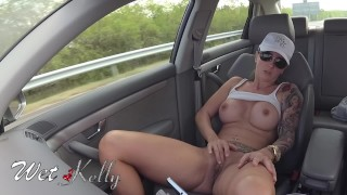 Big boobs tattooed girl masturbating in the car on the crowded highway