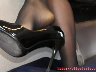 A young girl in high heel and dirty soles uses a man how footstool