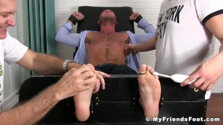 Classy jock in suit loves getting his feet tickled by two dudes