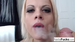 Nadia smokes an e-cig while also smoking a pole