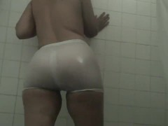 White spandex shorts and white t shirt in the shower transparent