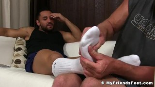 Tattooed muscular hunk masturbating while his feets get licked Shaved orgasm