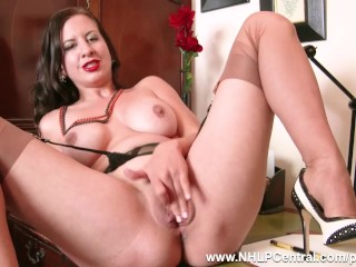 The Adult Video Experience Presents Busty brunette Tindra Frost masturbates in her vintage black seam nylons