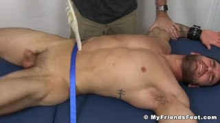 Muscular hunk tied up to a bed while his body is tickled hard porno