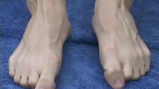Blonde jock Jason sukcing his own hot feet outdoors