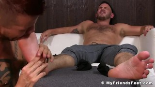 Jock is relaxing while his gay lover massage and licks his feet