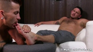 Jock is relaxing while his gay lover massage and licks his feet porno