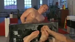Muscular jock Alex is tied up and tickled on his sexy feet
