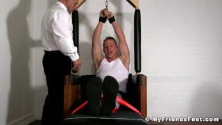 Two pervs tickling tied up jock all over his body in the prison Analized muscle