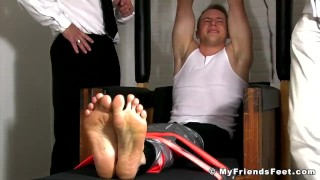 Two pervs tickling tied up jock all over his body in the prison Twink doggystyle
