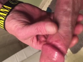 Playing with a cock ring and veiny cock