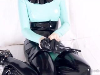 wearing latex catsuit with black and jade color combo