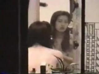 Amateur voyeur video of two Asians getting freaky