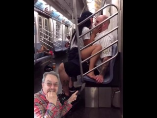 Girl rides guy on train in public