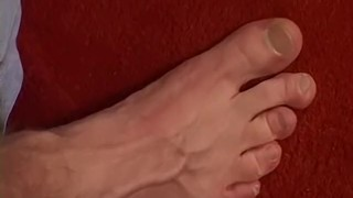 Handsome stud playing with his feet and slowly jerking off Indian tattoo