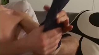 Handsome stud playing with his feet and slowly jerking off