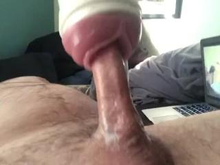 Tattooed guy fucks Fleshlight hard and sprays cum