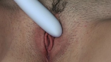 The girl masturbates with a vibrator and gets an orgasm
