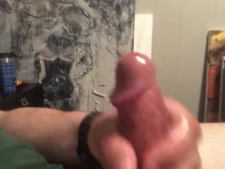 Cum spraying all over shirt while jerking off