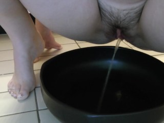 Peeing Into A Bowl With My Hairy Pussy