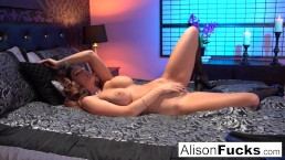 Alison posing nude in bed